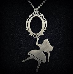 Alice in Wonderland necklace - looking glass - whimsical silhouette jewelry - long. $20.00, via Etsy.
