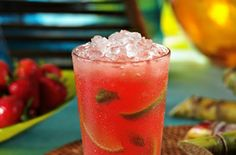 Bahama Breeze Strawberry Mojito!  Bacardi Dragonberry, Strawberry Pucker, fresh squeezed sugar cane juice, mint leaves, lime wedges and a splash of soda.