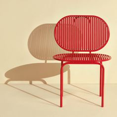 ROLL Collection by Studio Verena Hennig. The name is derived from the rolling aluminium sticks that form the seats and chair backs, which slide from left to right to massage the sitter.