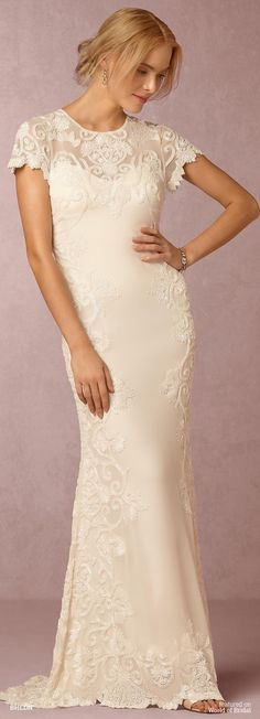 Hand-beading from shoulders to hem captivates; a sheer neckline and back add allure.