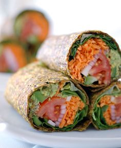 The Global Girl Raw Vegan Recipes: Gluten-free guacamole wraps with tomato, lettuce, bell pepper and red onion in a zucchini, apple and flax seed crust. – More at http://www.GlobeTransformer.org