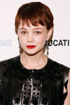 Happy Birthday, Carey Mulligan! See 11 of Her Best Beauty Looks: Back in 2008, Carey attended the MoMA Film Benefit Gala honoring Baz Luhrmann — five years before she would star in his adaptation of The Great Gatsby.  : Donning a reddish-brown hair color, red lipstick, and a leather ensemble at the 2009 New York City premiere of An Education, Carey's look skewed more edgy than sweet.
