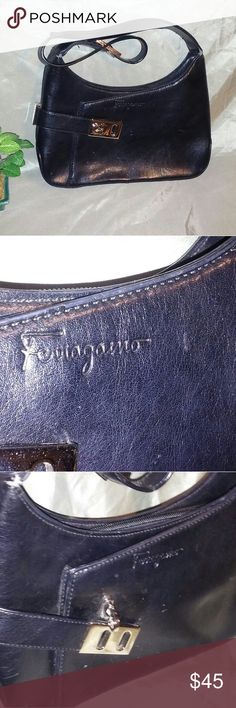 Ferragamo mini purse Pre-loved Ferragamo mini purse is made of black leather with a front silver clasp that closes a pocket. The inside has three compartments plus a zipper pocket, plenty of room for the essentials. There are a few scratches on the front and back and bottom which are barely noticeable until you get up close. The pictures definitely enhance and make it look worse than it is. Other than that it's a real find! 9x2x5 Ferragamo Bags Mini Bags