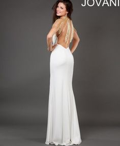 Long white prom dress 2014 by Jovani features beautiful beaded draping at  the neckline with a sexy slit at the skirt and open back dc62bf124