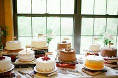 stacking the assortment of cakes on books! Such a good idea!
