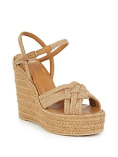 $595 for the shoes I had in grade school for about $35? Saint Laurent - Woven Espadrille Wedge Sandals