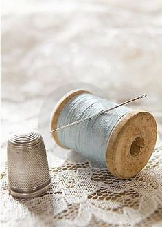 Buy Vintage Cotton Reel With Needle And Silver Thimble On Lace by daisy-daisy on PhotoDune. Vintage Cotton Reel With Needle And Silver Thimble On White Lace Thread Spools, Needle And Thread, Blue Cream, Blue And White, White Lace, Little Mercerie, Vintage Sewing Notions, Sewing Baskets, Wooden Spools