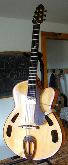 Alan Carruth Archtop Guitar with a rather unique design.