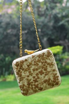 Indian Wedding Gifts - White Clutch with Gold Wired Embroidery as a Gift? Perfect for your Sister or Mother | WedMeGood | Clutch by: Clutch'd #wedmegood #indianweddinggift #clutch #white #gold