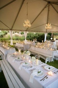 An elegant tent with long tables and beautiful details.      Photo:  Andrew Bryant Photography