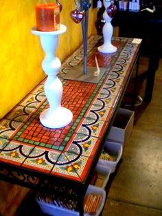 Nice idea for mosaic.... full tile pieces on edge with mosaic center.  hmmmm.... ideas, ideas....