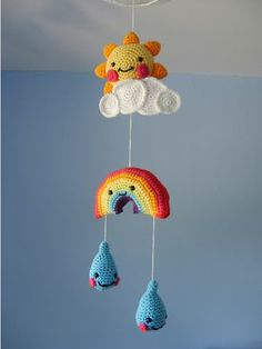 Knitted and crocheted mobiles.