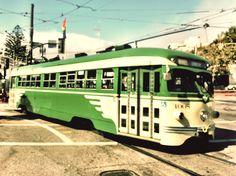 "Muni streetcar no. 1008 in it's original green and cream ""wings"" livery at Castro & Market."
