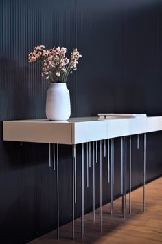 The ATMOSPHERE Sideboard is the perfect combination between contemporary design and the concept of art furniture. It is a piece with exclusive manual production, with a maximum attention to details. The metallic base reinforces the idea of lightness and elegance.