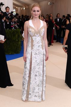 Game of Thrones's Sophie Turner is the first member of Team Louis Vuitton to arrive. The statuesque actress is wearing a white lace number by Nicolas Ghesquière that seems inspired by his Fall 2017 Vuitton collection.