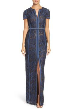 Floral lace panels enhance the modern romance of this tailored short-sleeve gown with a split neckline and skirt.