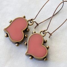 Resin jewellery is so easy to make! This tutorial covers how to use resin and pigment to make these adorable faux enamel earrings.