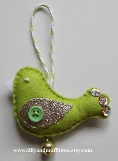 Handmade felt lime green and gold bird decorations/ornaments for Christmas or other occasions. This listing is for ONE bird. Each bird is made from wool blend felt & gold glitter fabric and is accented with french knots,sequins,a bell, and a lime green button. Each bird is finished