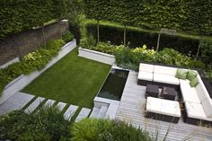 Seating and lawn aerial. Landscape design. Back yard.