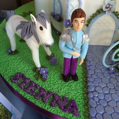 Castle cake detail! #blue #white #lavendar #purple #cindarella #party #classy #fresh #no filter #meringues #birthdayinabox #girl #fiveyear #disney #princess #cupcakes #dresses #clockstrikesmidnight #glassslippers #cake #castlecake #lavendercake #towers #princecharming #horse #cindarella #icingchariot #pumpkin #biscuits #pumpkinbiscuits #chariotbiscuits #pastels  #cakepops #redvelvet  #personalisedinvites #buttonbiscuits #rosepiping #carrotcake #jloschutte www.jacindalouw-schutte.com