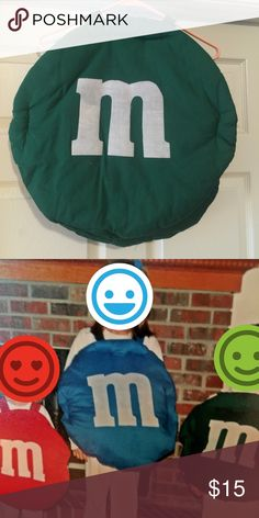 Green M&M costume Green M&M Halloween costume.  2 identical pcs joined together on shoulders an both sides.  It just slips over your head.  Was worn with white sweats underneath.  I also had a red and blue, but have not found them yet. Will post if I do. Price firm. Meas 18.5x18.5 Costumes Halloween