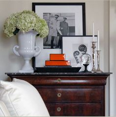 Love the stacking of frames and use of space on a side chest