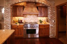 Would love to have a brick wall behind the stove area.