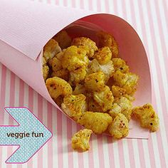 Cauliflower popcorn (Break a head of cauliflower in bite-size florets, then spread them on a baking sheet lined with parchment paper. Spray the cauliflower lightly with butter-flavor cooking spray, then sprinkle lightly with turmeric, freshly ground pepper, and sea salt. Bake 20 to 30 minutes at 425 degrees F or until the cauliflower is slightly browned.)