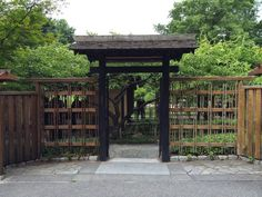 Aged Japanese Fence Design With Green Front Yard And Flagstone Floor For…