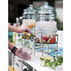 Cold Beverage Jar with Stand in Pitchers and Decanters | Crate and Barrel - these would be so much fun