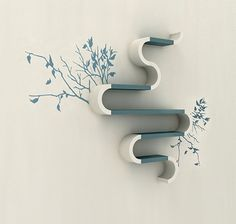 I don't exactly like this, but I like tying in a color of shelving into a wall decal