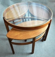 Courtesy of our Apartment Therapy Classifieds, this awesome round coffee table has three nesting tables tucked under its glass top. Find more of our finds in the links after the jump.