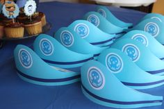 Octonauts party hats -- made with elastic and cardstock.  Logo downloaded from internet.  2014.