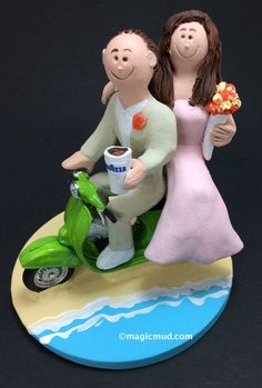 Scooter Wedding Cake Topper - Custom Made Vespa Riders Wedding Cake Topper, Moto Scooter Wedding Cake Topper, Cafe to Go Wedding Cake Topper    This photographed listing is but an example of what we will create for you....simply email or call toll free with your own info and pictures of yourselves, and we will sculpt for you a treasured memory from your wedding!    $235   #magicmud   1 800 231 9814   www.magicmud.com