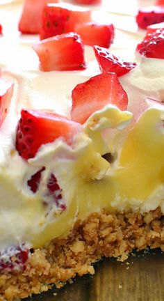 Strawberries & Cream Lush Dessert ~ Combines a crunchy cookie crust with vanilla pudding, whipped topping, and fresh strawberries for a delicious summer treat that's guaranteed to become a favorite!