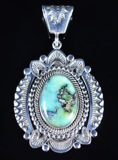 Handmade pendant, with natural Peacock Variscite, by Navajo artist Ned Nez.