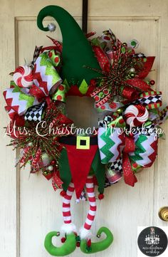 This is a Christmas wreath made with premium deco mesh. It features a red and Green elf. This is a very colorful wreath and is lots of fun! It would look great on your front door!! Wreath measures 24H x 24W not including legs and hat. See more items http://www.etsy.com/shop/mrschristmasworkshop