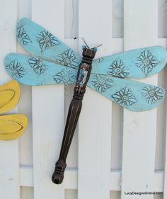 blue textured wing table leg dragonfly Made with fan blades and a table leg.