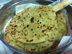 Kaachu Paratha (Fiji Indian Recipe) Made with fresh green garlic and it's leaves), this aloo (potato paratha is absolutely unique and simply delicious). The garlic is lighter in flavour. Recipe on Mayuri's Kitchen: https://www.facebook.com/media/set/?set=a.304486866329483.68017.196278273817010=1