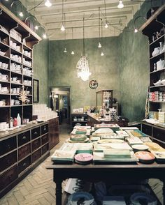 Retail, herringbone floors, cabinetry, large center table