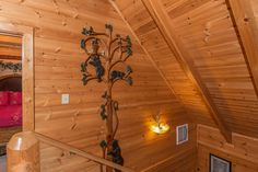 Professional photo of the hand carved tree with bears and bees. May, 2016    Pat Kirchhoefer, owner  Escape to Times Past    #mybearfootcabins #smokymountains #pigeonforge #vacationrental #cabinlife #cabin #gatlinburg #sevierville #cabinrental #vacation #mountains