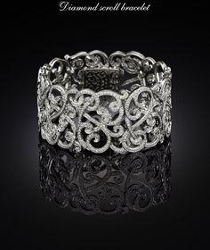 please don't let these be blood diamonds! Diamond scroll bracelet