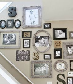 Thrift store frames and other gathered nicknacks combine for a monochromatic, monogram-filled display.