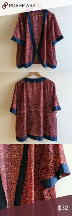 Open Front Silky Kimono Style Blouse Gorgeous navy accents warm patterning on this silky blouse. No brand markings,  but amazing quality and in like new condition. This top hangs open with no closure. Tops Blouses