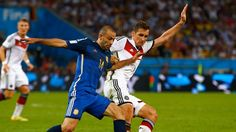 Javier Mascherano of Argentina competes for the ball with Miroslav Klose