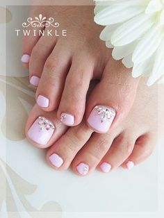 Light pink and jeweled toenails