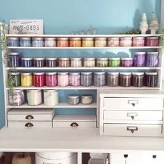Store yarn and other craft items in clear mason jars then sort and organize by color.