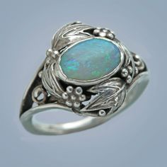 Bernard Instone. Arts and Crafts ring.  Silver and opal.  H: 1.7 cm (0.67 in).  British, c. 1925.
