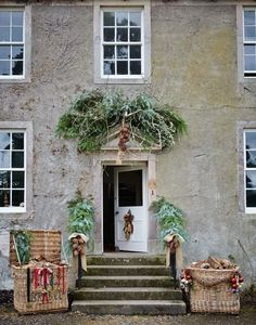 Front Door Christmas Decor With large Leaves and Baskets