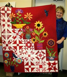 Such a cute idea combining patchwork squares and applique!Show 'n Tell Jan A different way to piece a sampler quilt with a modern twist on the traditional. flowers could be replaced with Christmas applique .I can see Santa sitting on a step.mix of piecing Patchwork Quilting, Scrappy Quilts, Applique Quilts, Amish Quilts, Quilting Projects, Quilting Designs, Quilting Ideas, Red And White Quilts, Christmas Applique